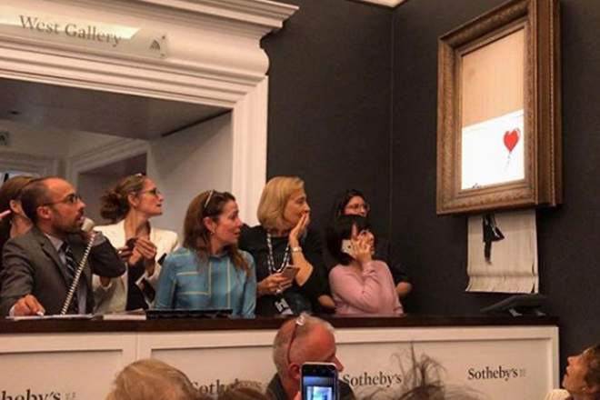 British Artist Banksy's Painting Self-Destructs Minutes After Being Auctioned For $1.4 Million