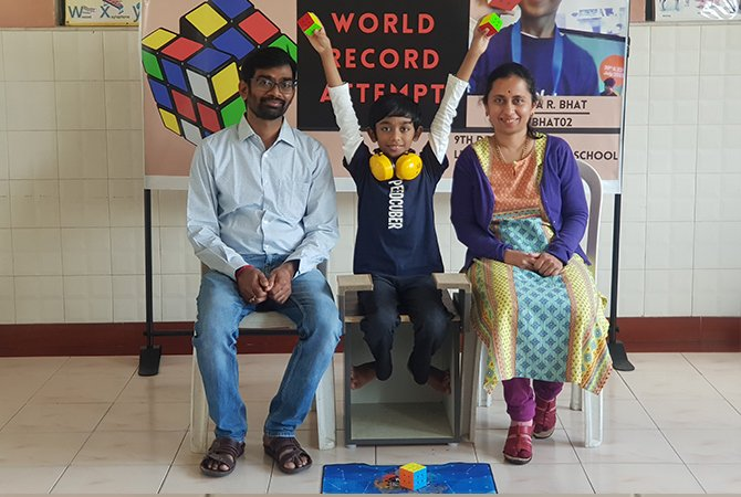 Eight-Year-Old Sets Guinness World Record For Solving Three Rubik's Cubes Simultaneously
