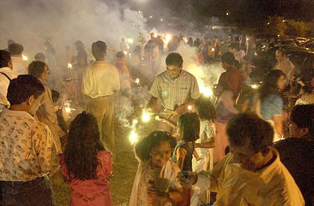 How do Sikhs celebrate Diwali differently than Hindus?